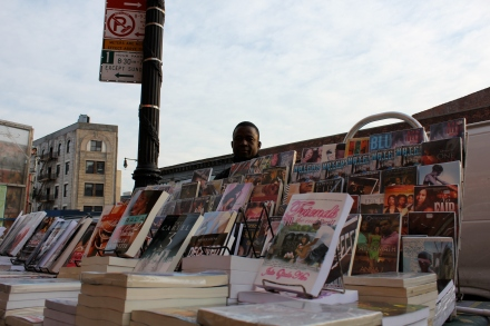 Souleymane Porgo Behind His Book Stand (photo by Stuart White)